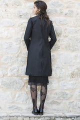 a brave woman trench coat