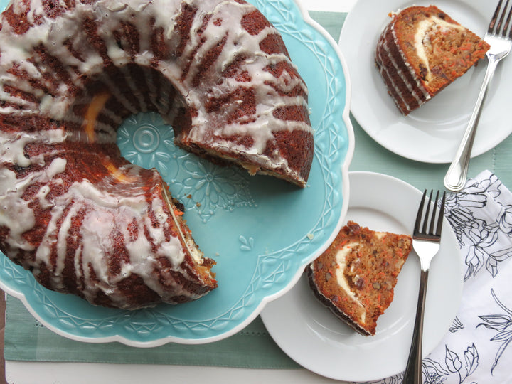 Cheesecake Swirled Carrot Bundt Cake with Walnuts and Raisins
