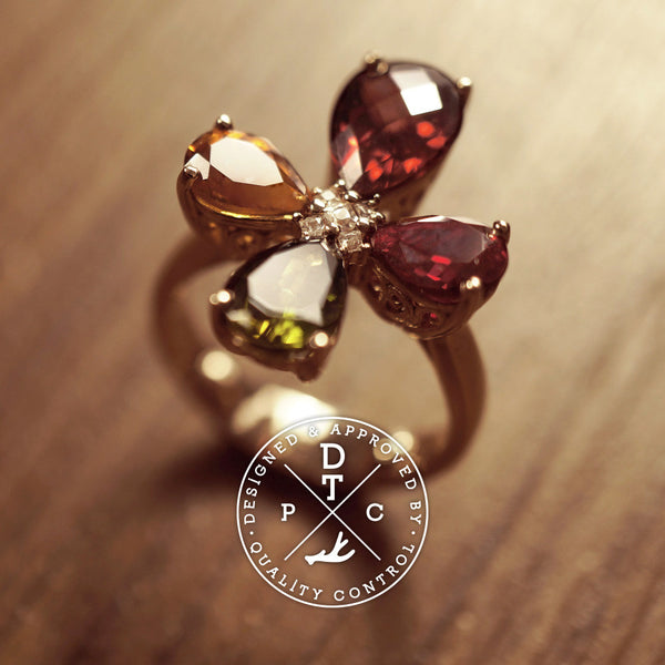 Tailor-made 18K Rose Gold Ring with various precious stones, clover design