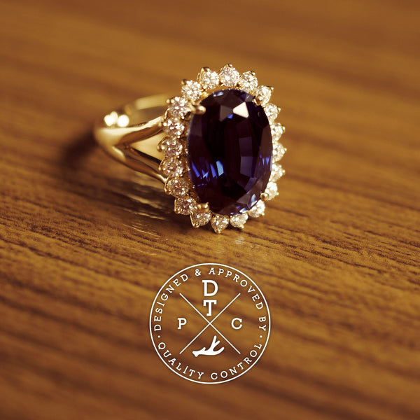 Tailor-made 18K yellow gold sapphire ring with diamonds