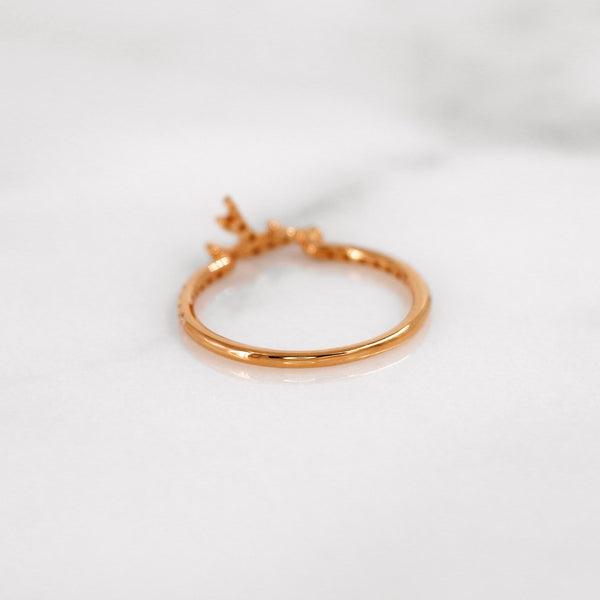 Delicate diamond antler ring in rose gold.