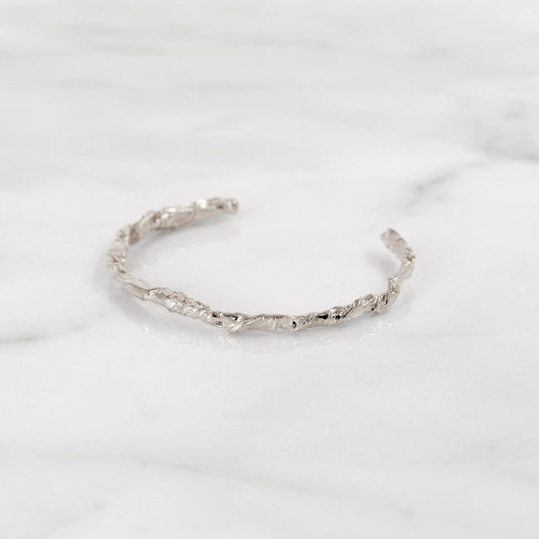 Elegant sterling silver paper bangle