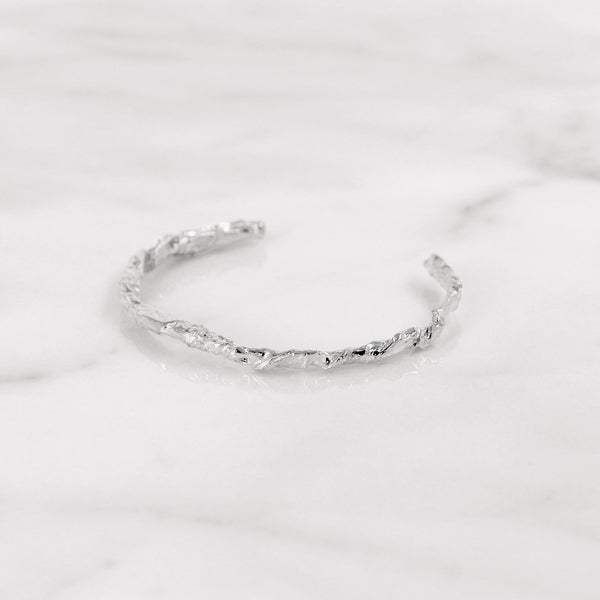 Elegant white gold paper bangle