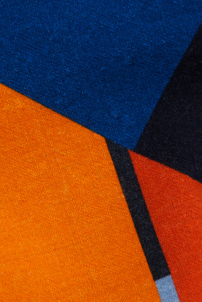 detail of the shawl showing a red orange and blue color motif