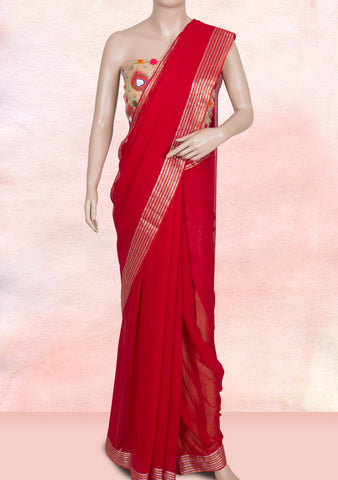 Red plain saree with net blouse piece