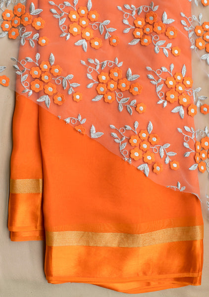 Orange plain saree with embroidered blouse piece