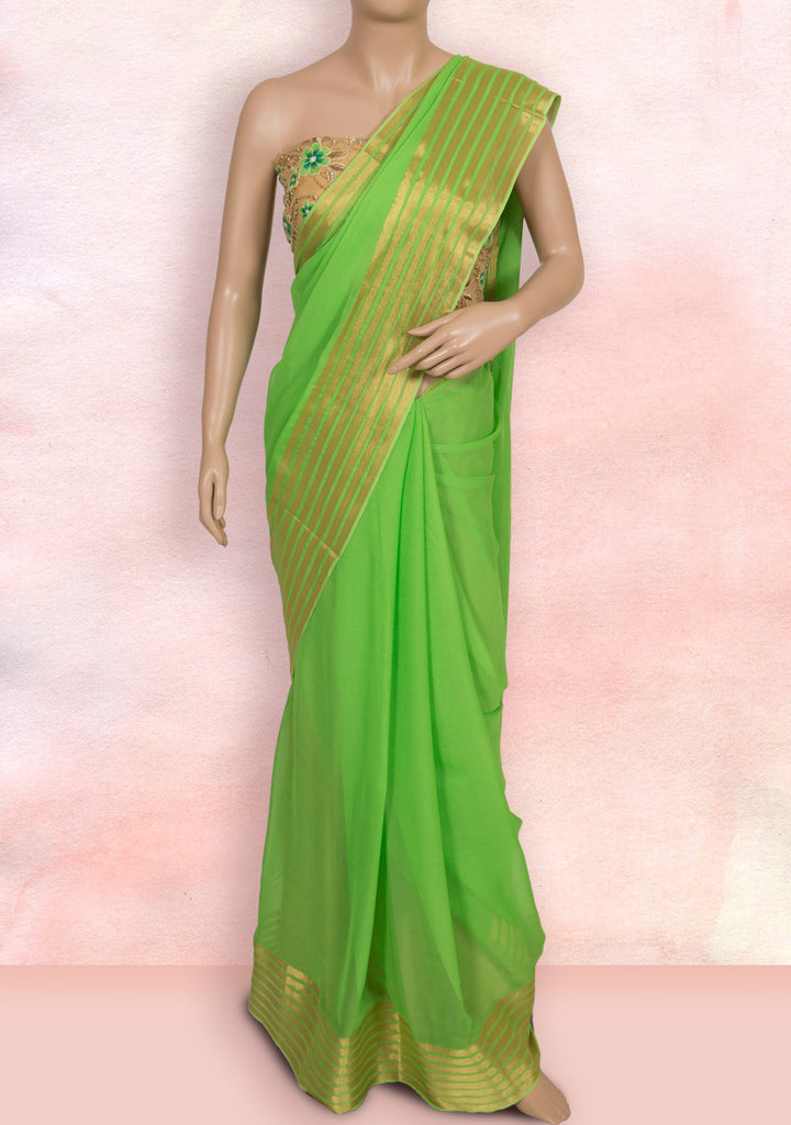 Green plain saree with net blouse piece