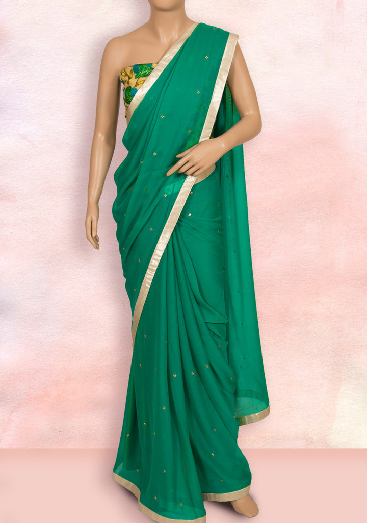 Green saree with silver border, stone buttis and net blouse piece