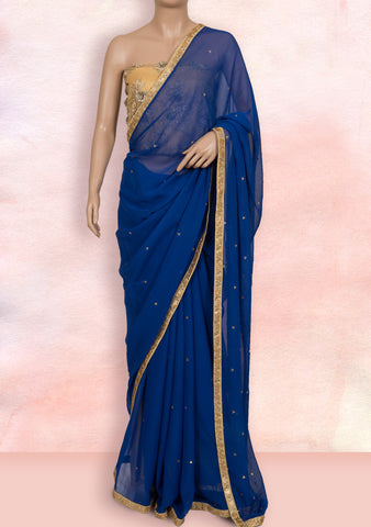 Blue saree in lace, stone buttis and net blouse piece
