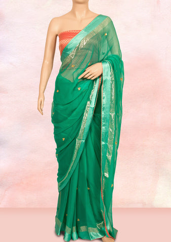 Peacock green saree with gota work buttis and georgette brocade blouse piece