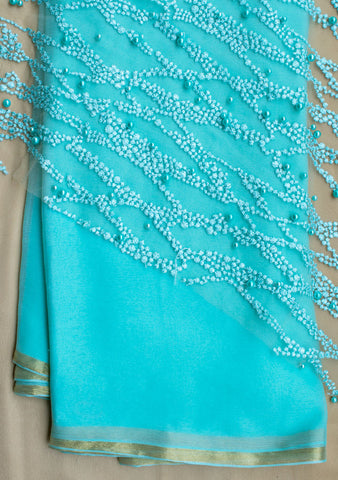 Sky blue plain saree with net blouse piece