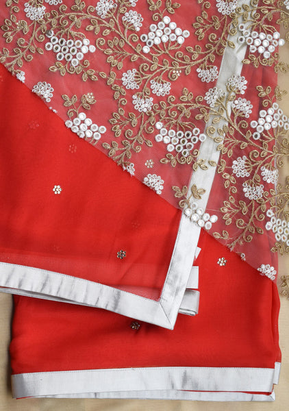 Bright red saree in silver border, stone buttis and net blouse piece