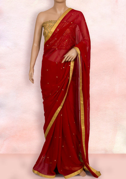 Red saree in gold border, stone buttis and net blouse piece