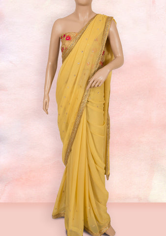 Beige saree in lace, stone buttis and net blouse piece
