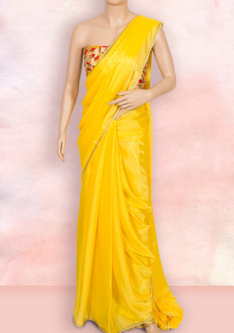 Yellow plain saree with net blouse piece