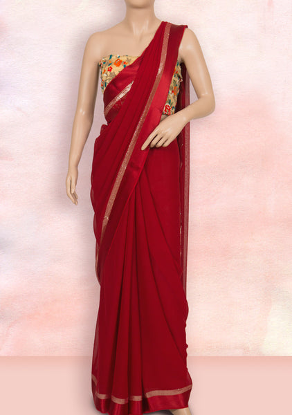 Red saree with net blouse piece
