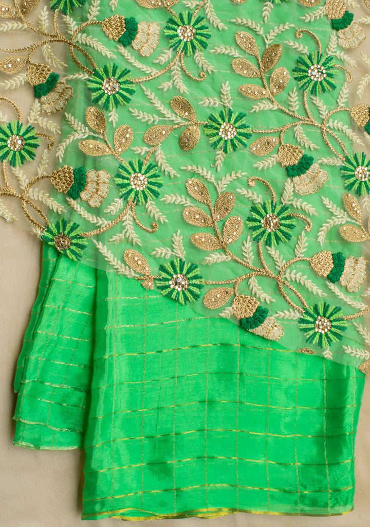 Green checks saree with net blouse piece