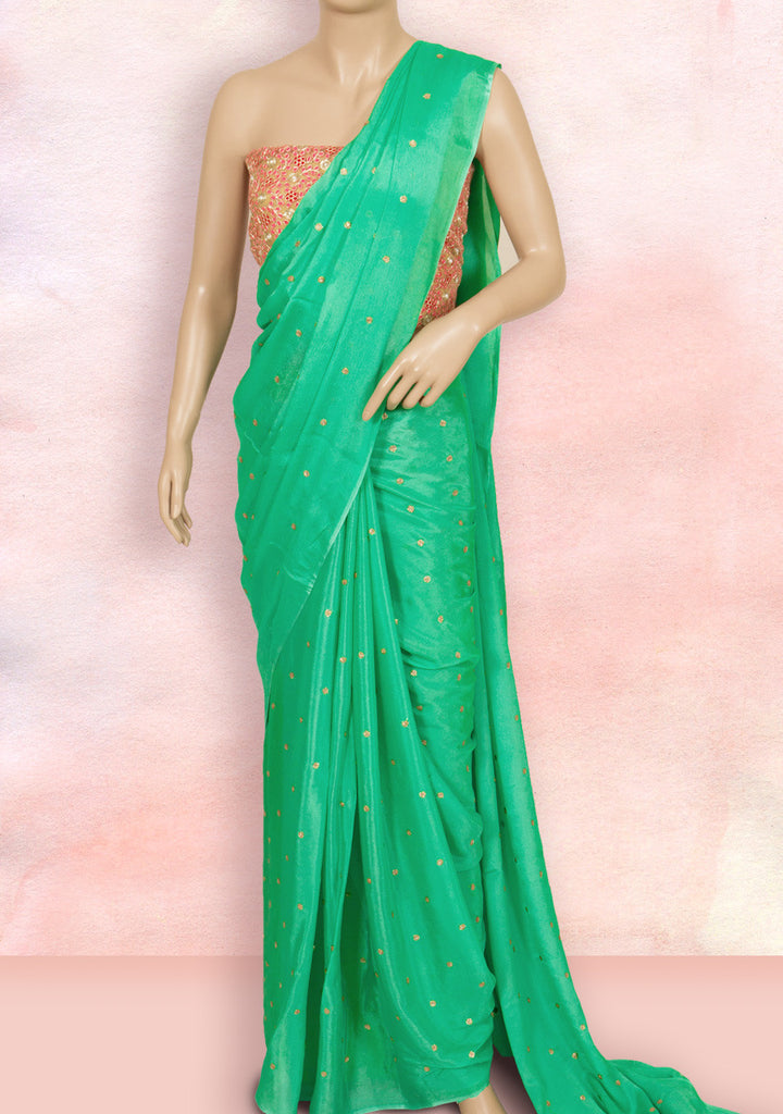 Sage green saree with small sequins buttis and a contrast pink blouse piece