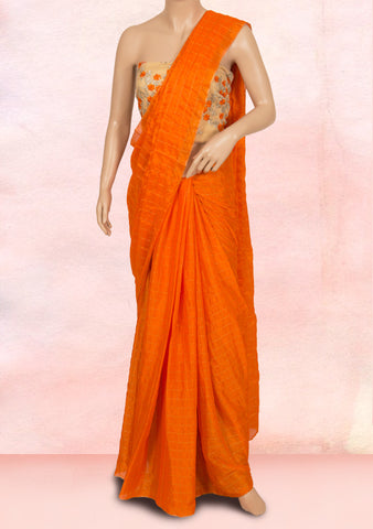 Orange checks saree with net blouse piece