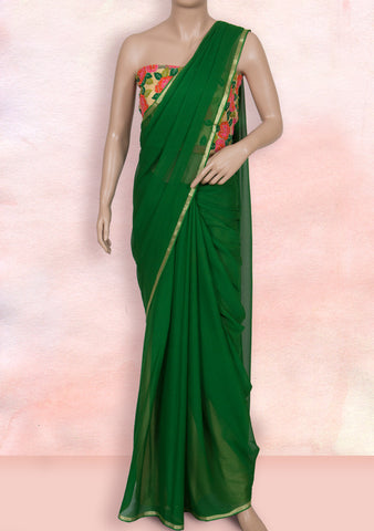 Dark green georgette saree with net blouse piece