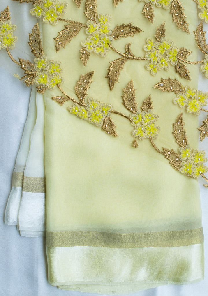 Yellow shaded saree with net blouse piece