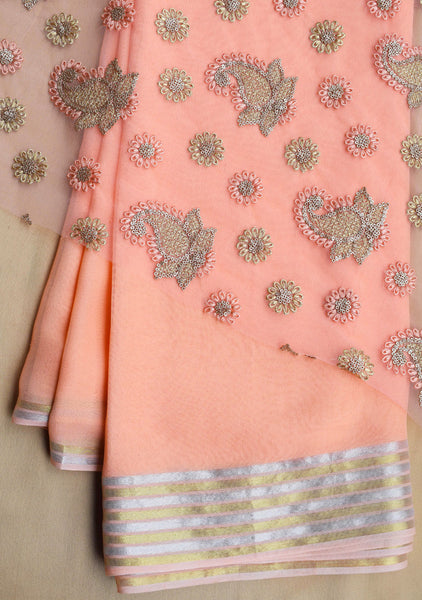 Peach Georgette saree with net blouse piece