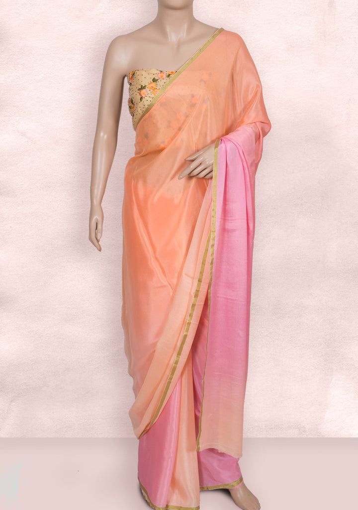 Peach pink shaded saree with net blouse piece