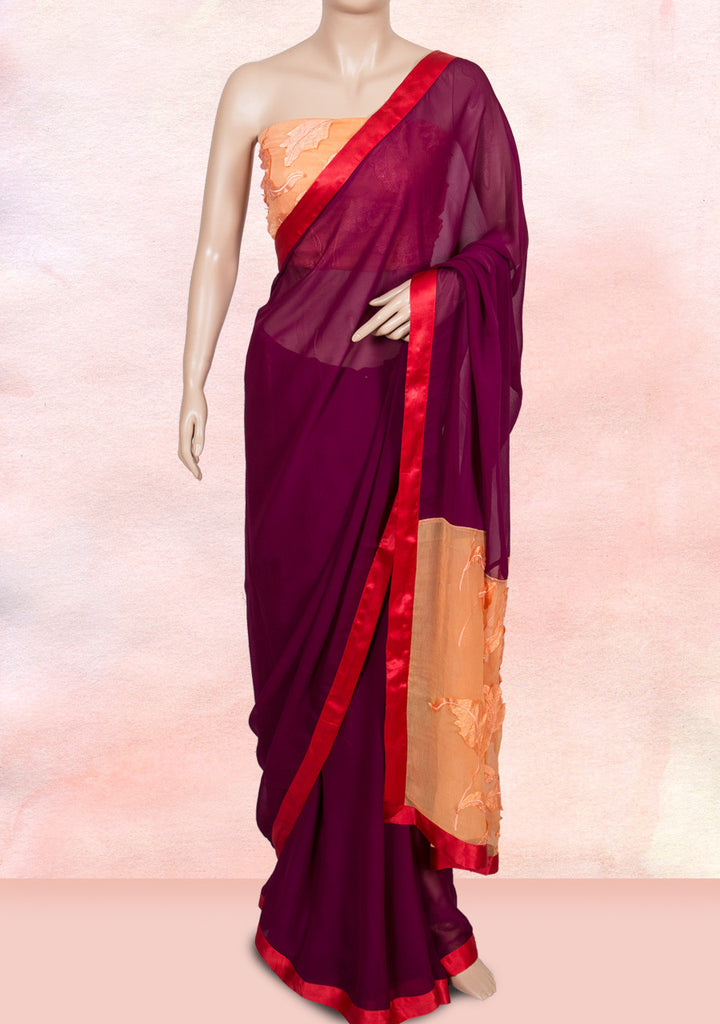 Purple saree with orange pallu adorned with applique leaves