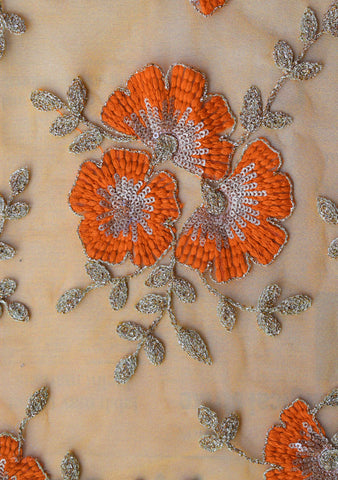 Orange thread and sequins embroidery on net