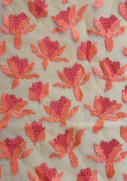 Thread cross-stitch embroidery on net