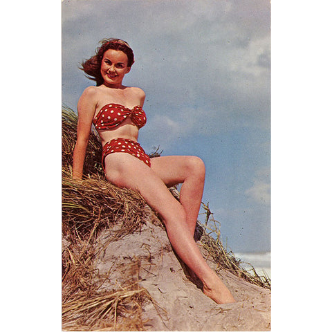 Brunette Bathing Beauty Red Polka Dot Bikini Sitting on Sand Dune Vintage Postcard (unused) - Vintage Postcard Boutique