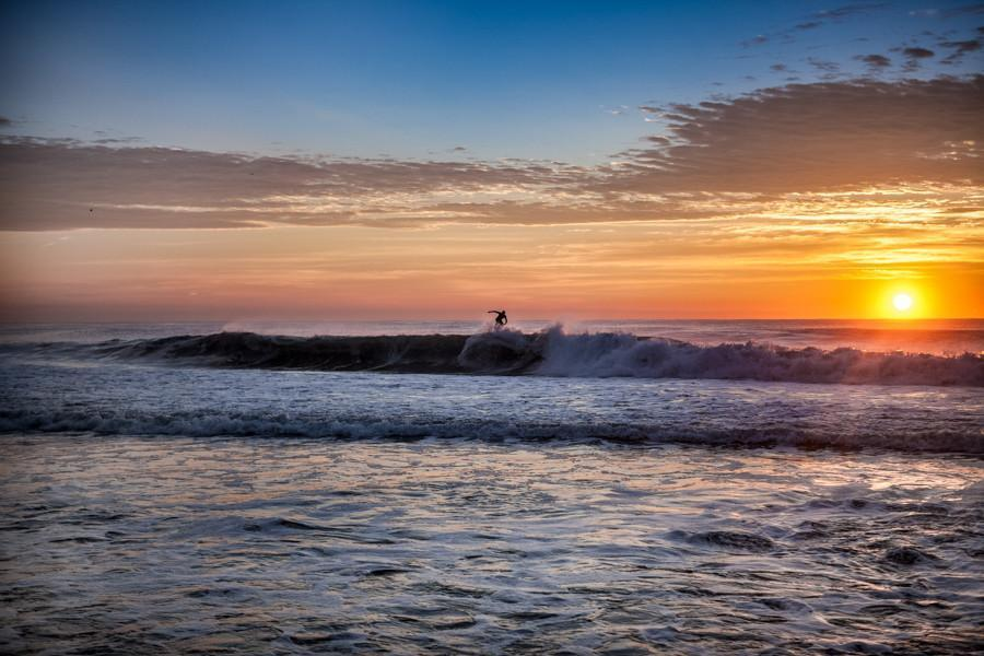 Surfer riding high at Sunrise - Bill McKim Photography -Jersey Shore whale watch tours