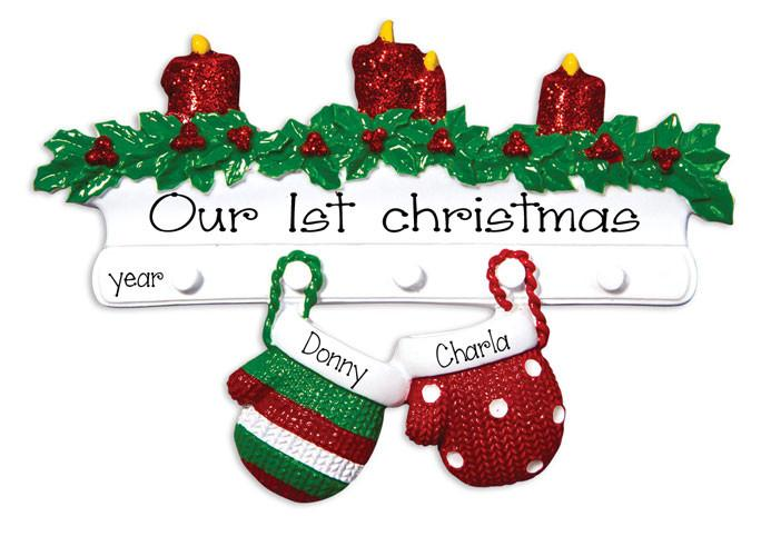 couples 1st christmas decorating christmas tree 1299 couples hanging mittens ornament