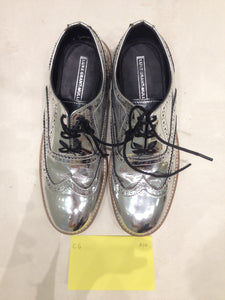 Ladies 8.5 Gents 7 US | 6 UK | 39 EU Silver/mirror/chrome (sample sale) A10