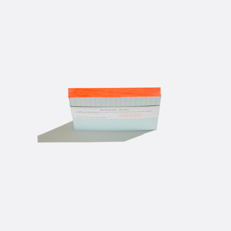 Before breakfast mini notepad with grids in blue and orange binding. Handmade in london