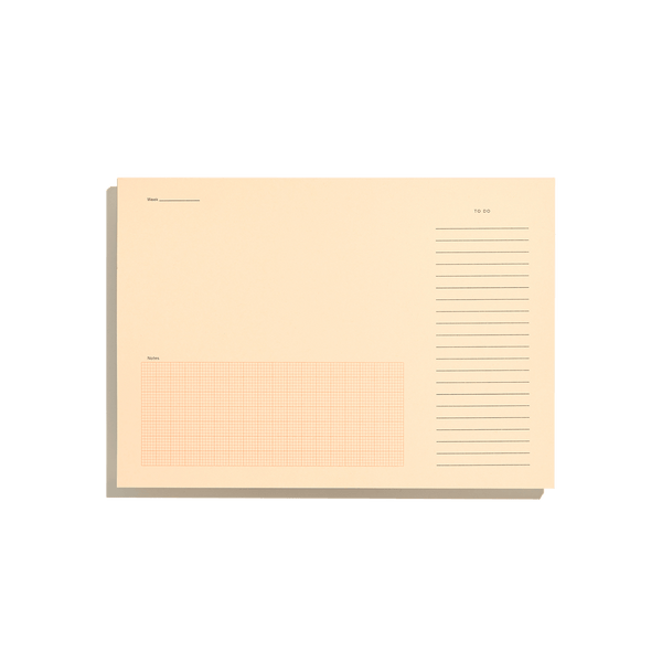 Before breakfast desktop notepad in pale orange and fluro orange. handmade in london