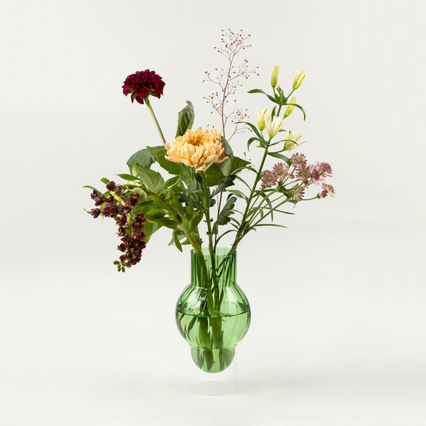 Green glass vase by Studio about