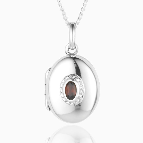 Product title: Silver and Garnet Locket, product type: Locket