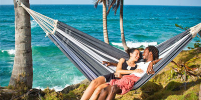 Couple on hammock by sea
