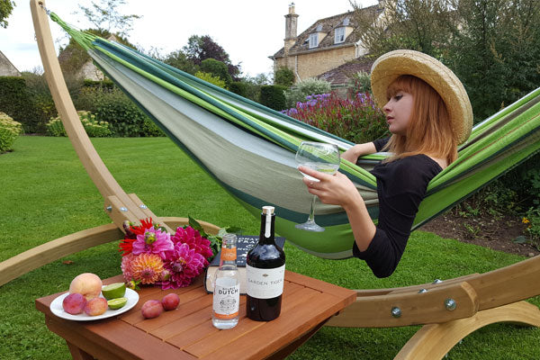 Woman in hammock drinking gin and tonic