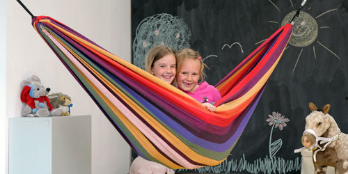 Two children sitting in hammock