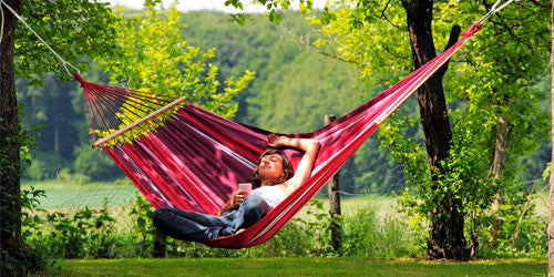 Girl sitting sideways in hammock