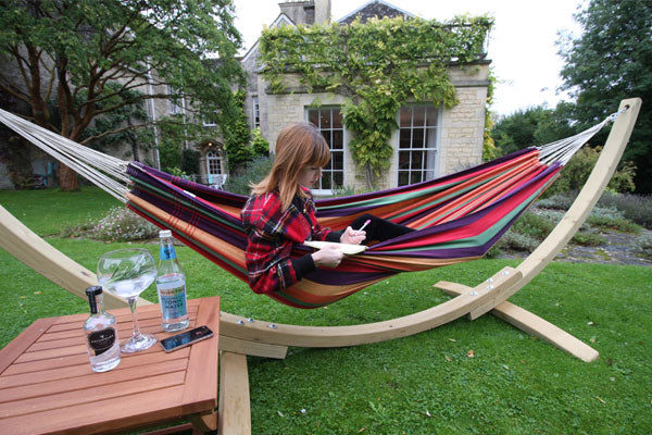 Woman writing sat in hammock