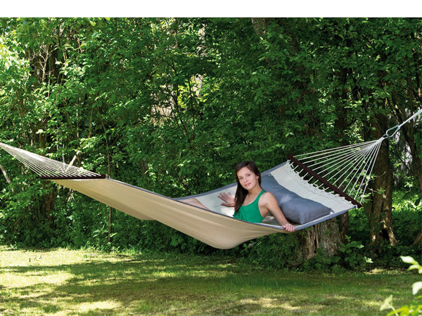 Girl sitting up on American Dream Sand hammock with darker pillow