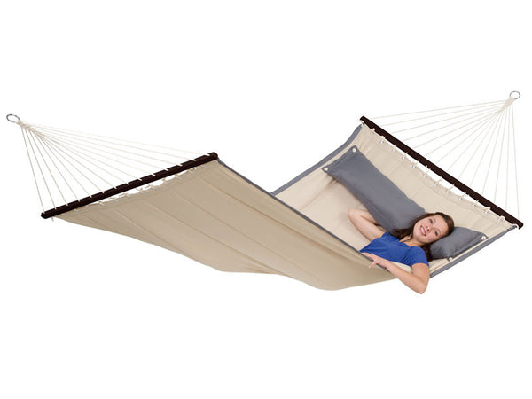 Girl relaxing on American Dream Sand hammock with darker pillow
