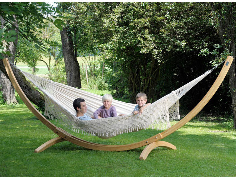 father and two children in large hammock suspended from arcus hammock stand amazonas large wooden hammock stand   arcus   hammock barn  rh   hammockbarn co uk
