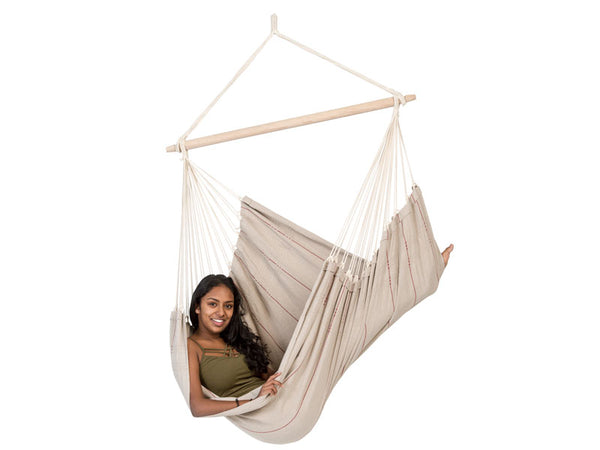 Girl sitting in Artista Sand Hammock Chair