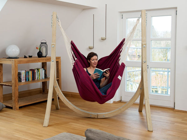 Girl sitting indoors in Artista Vino Hammock Chair hung on a stand