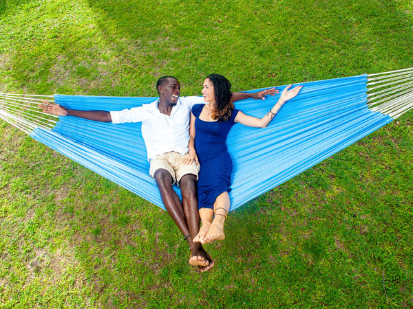 Arial view of couple lying in Arte Blue double hammock