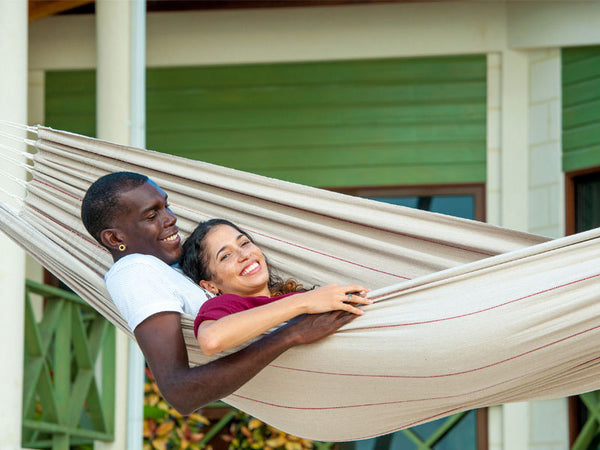Close up of couple lying in Arte Sand Hammock